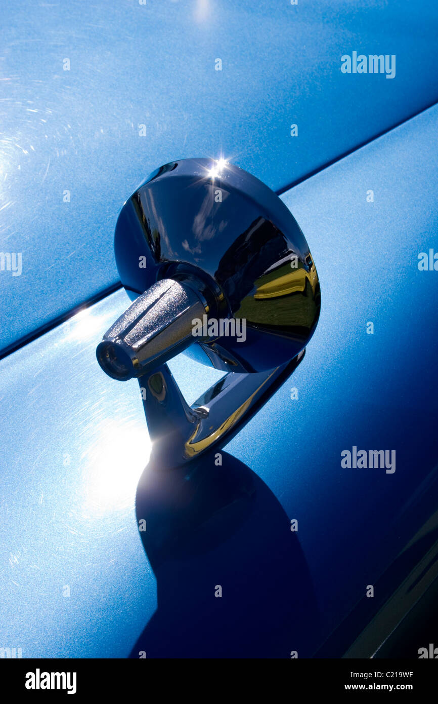 car body work panel shine gleam blue green Daimler wing mirror chrome reflect mold moulding pressed steel shape - Stock Image