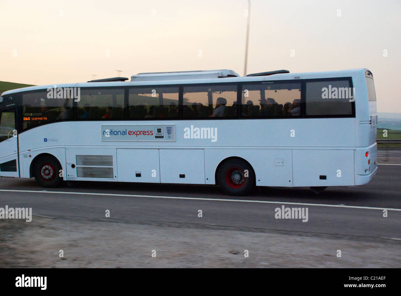 White coach on the M62 motorway (near Huddersfield). - Stock Image