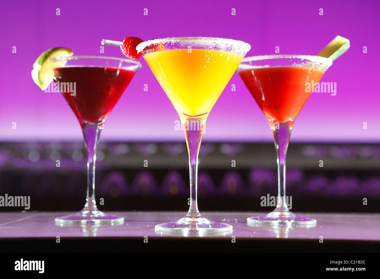 Fruit cocktails on a bar. - Stock Image