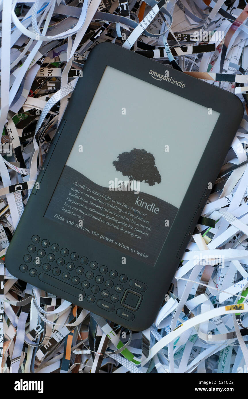 A Kindle 3 in a nest of shredded paper - Stock Image