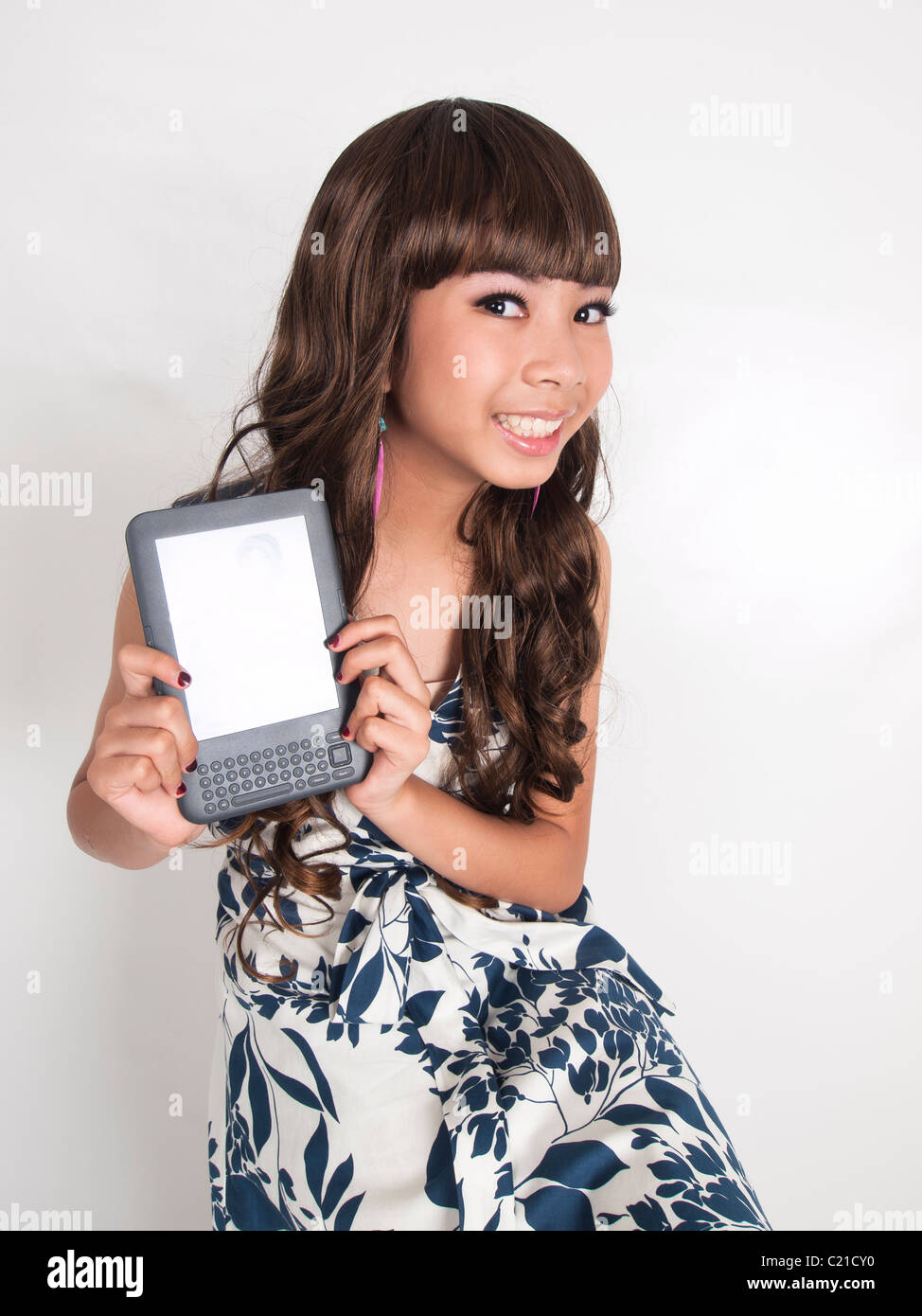 A cute girl hand hold her kindle e-book - Stock Image