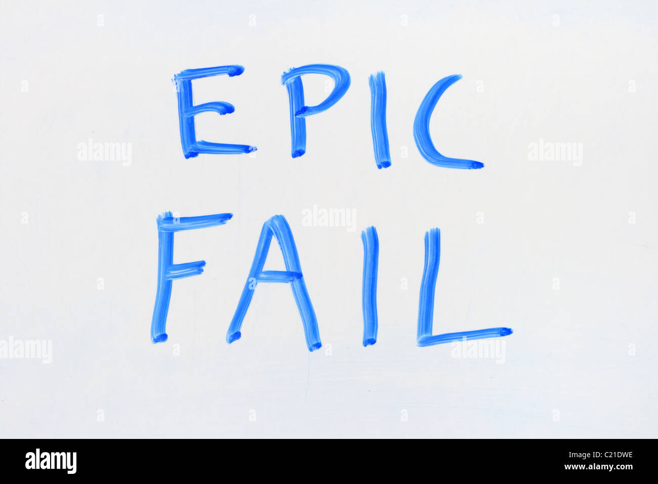 epic fail written in blue marker on a dry erase white board - Stock Image