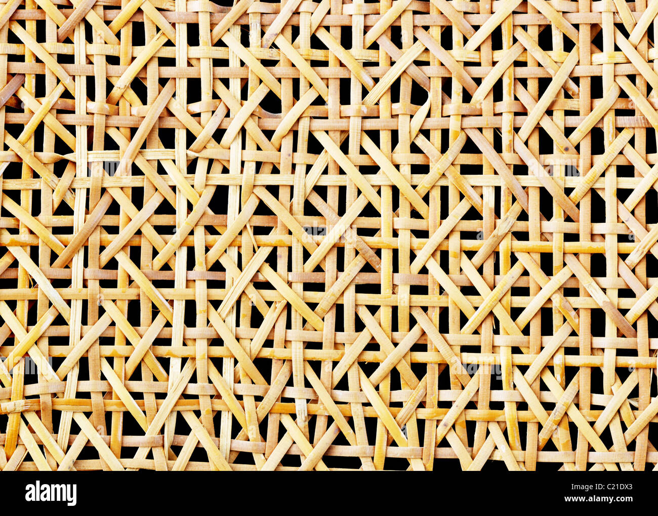 woven wicker mesh with black background - Stock Image