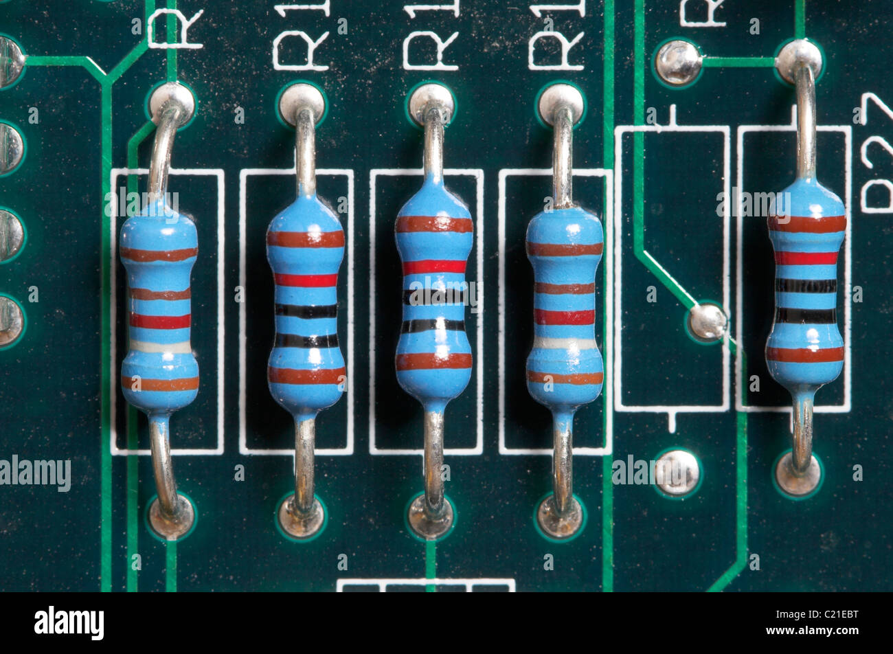 Resistors mounted on a printed circuit board. - Stock Image