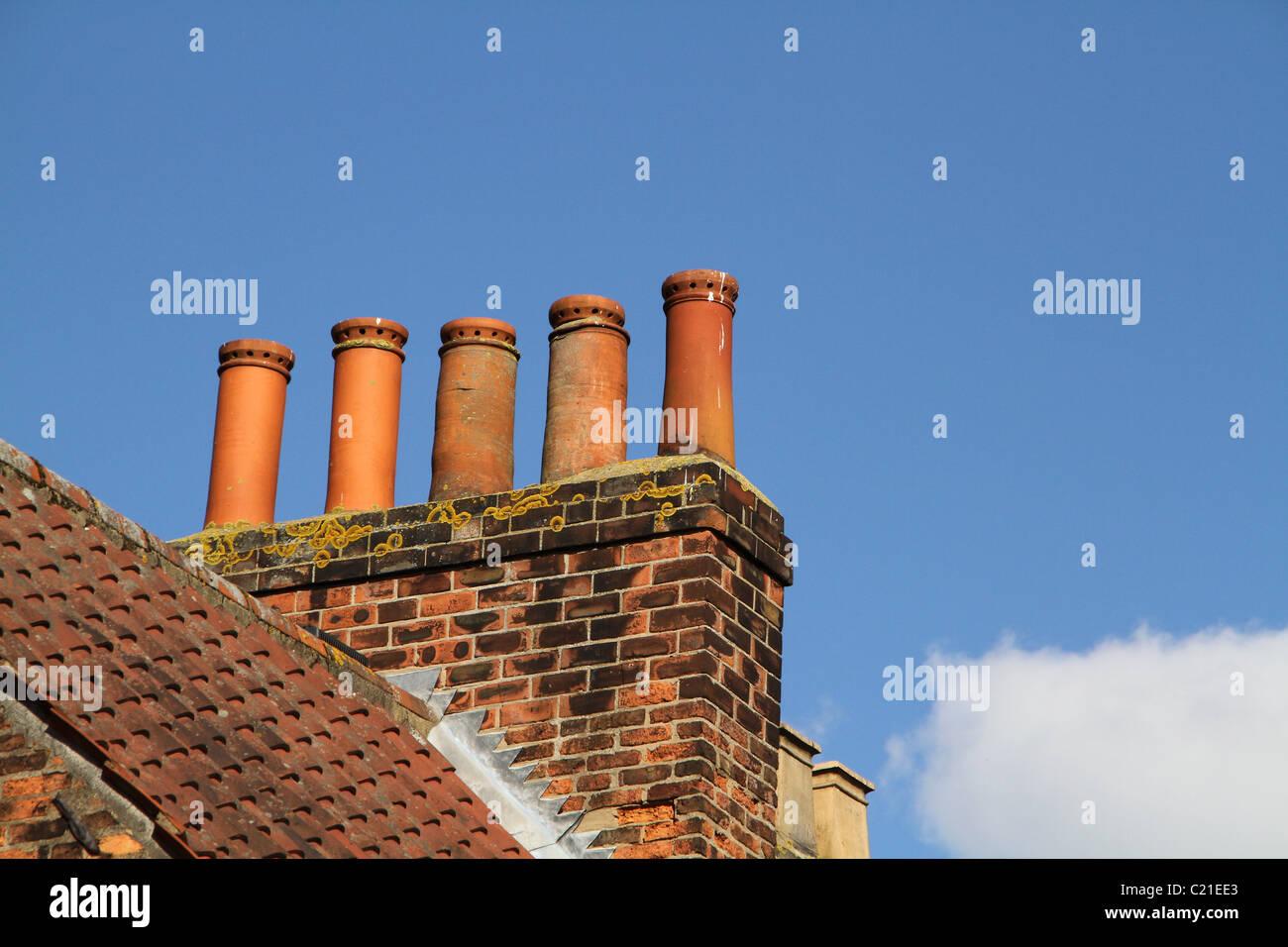 Terracotta chimney pots. - Stock Image