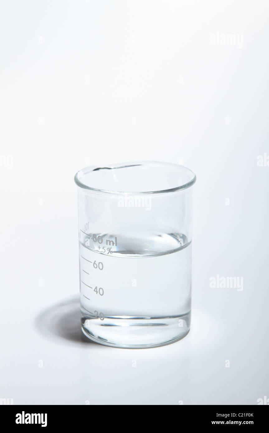 A 100-mL beaker containing water. - Stock Image