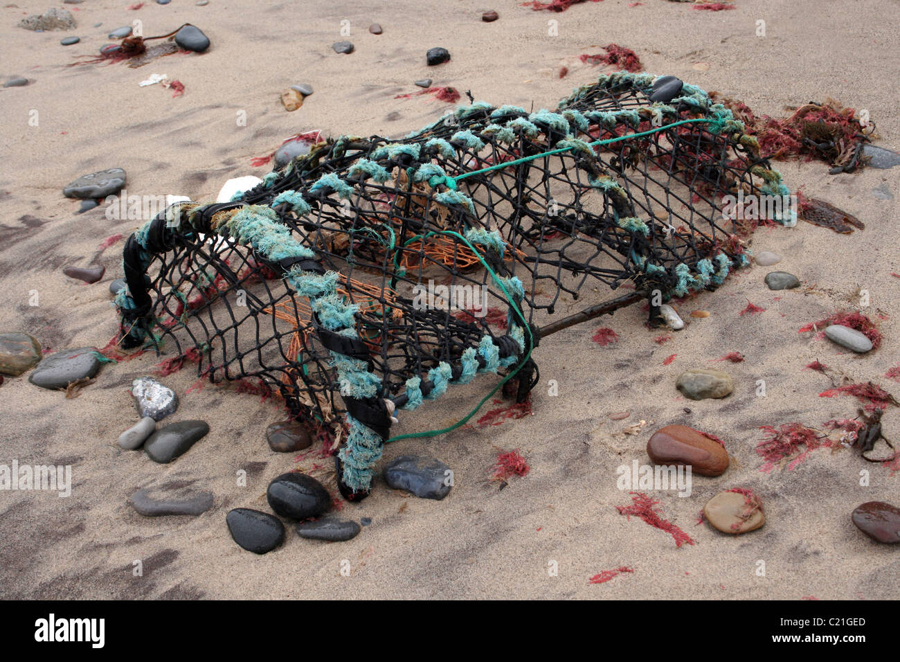 Lobster Pot Embedded In The Sand Taken at Spurn Point, UK Stock Photo