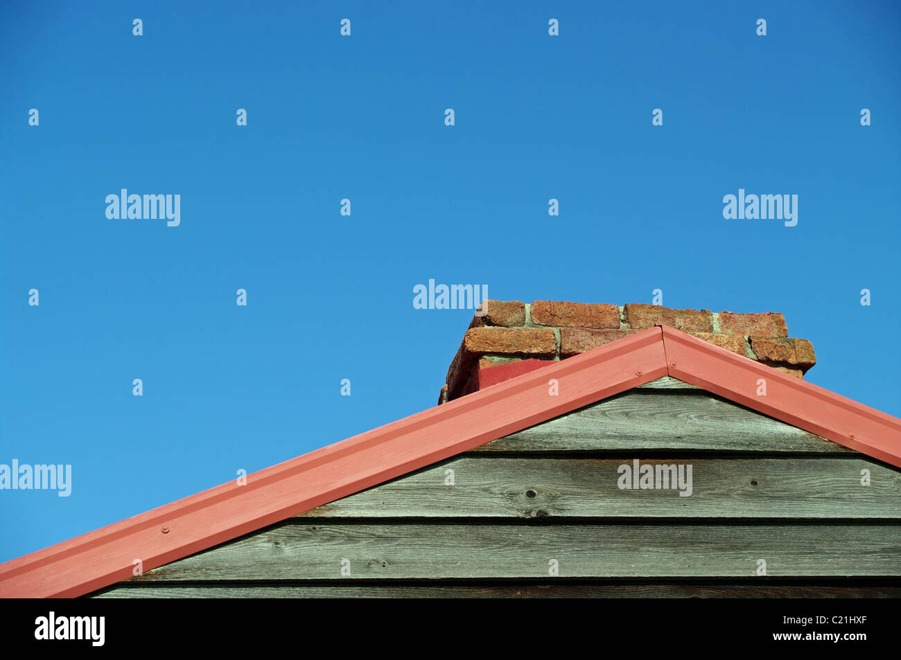 wooden gable end and chimney - Stock Image