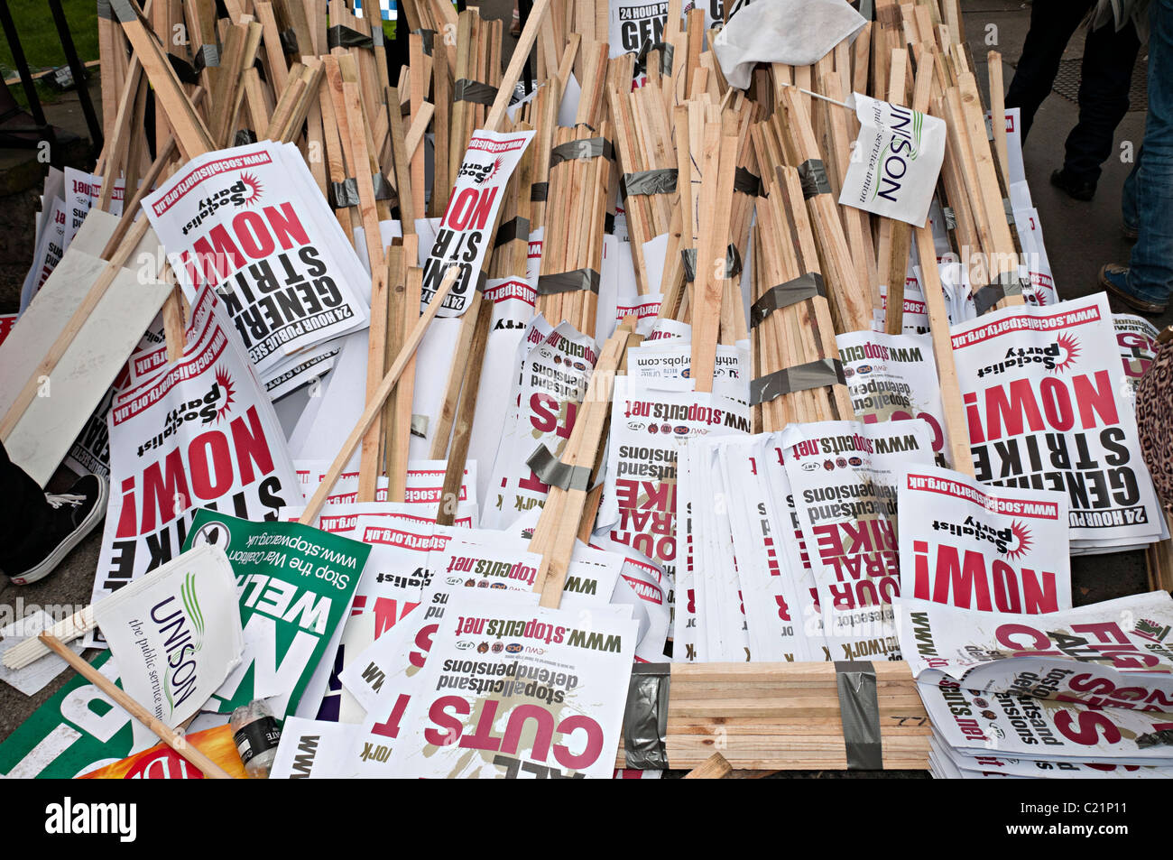 piles of placards on the floor at the tuc march for change rally in london 16th march - Stock Image