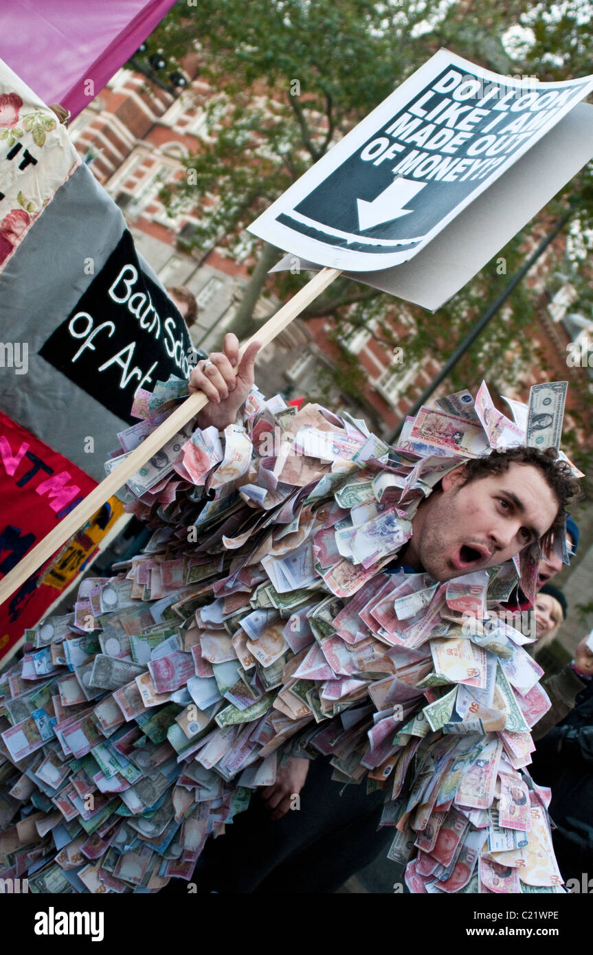 Student covered in fake banknotes at the protest against University fees, London, 09/12/2010 - Stock Image