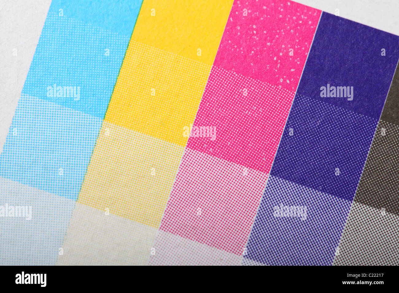 Printers printing CMYK colour test print on packaging four 4 color processing printing - Stock Image