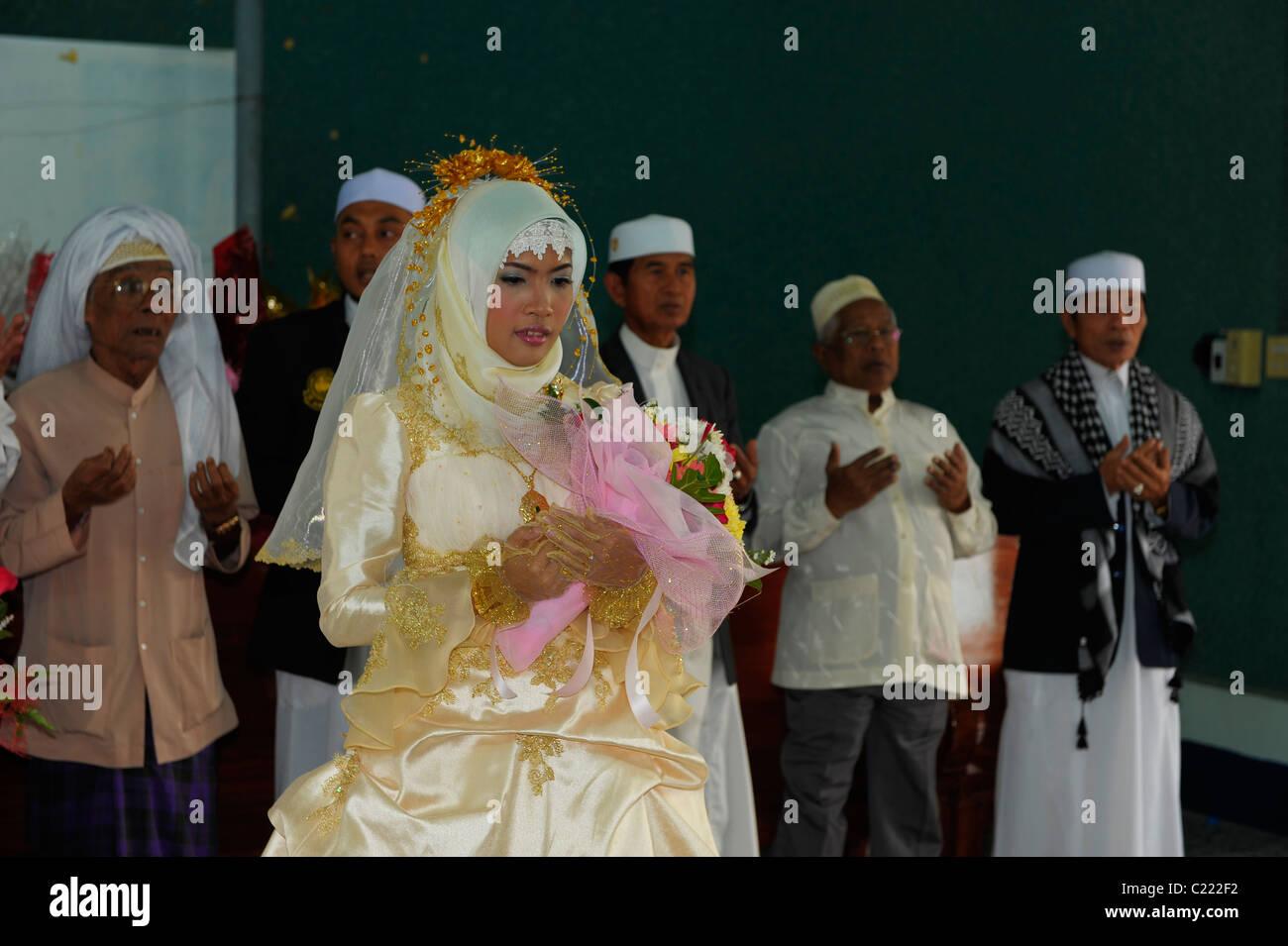 muslim bride praying during wedding ritual, islamic wedding , muslim community , bangkok, thailand - Stock Image