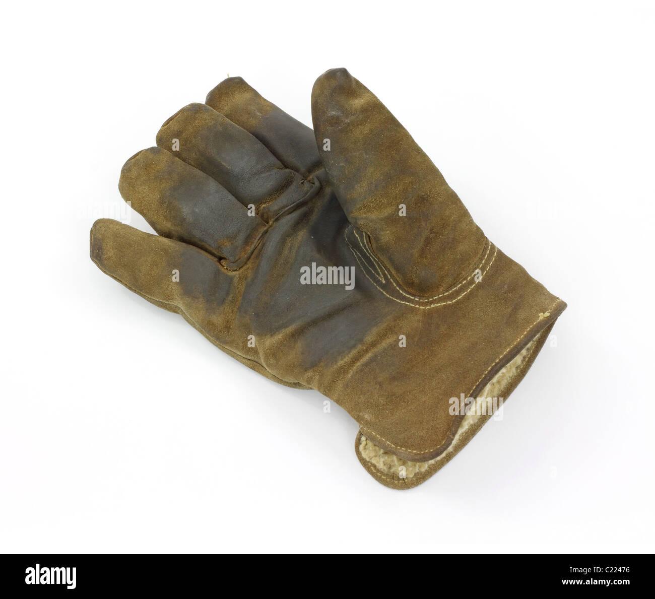 Worn work glove - Stock Image