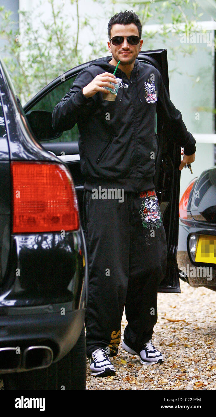 8aaa9878f29e Peter Andre arriving home drinking a starbucks coffee and wearing an Ed  Hardy tracksuit and Nike trainers. Brighton