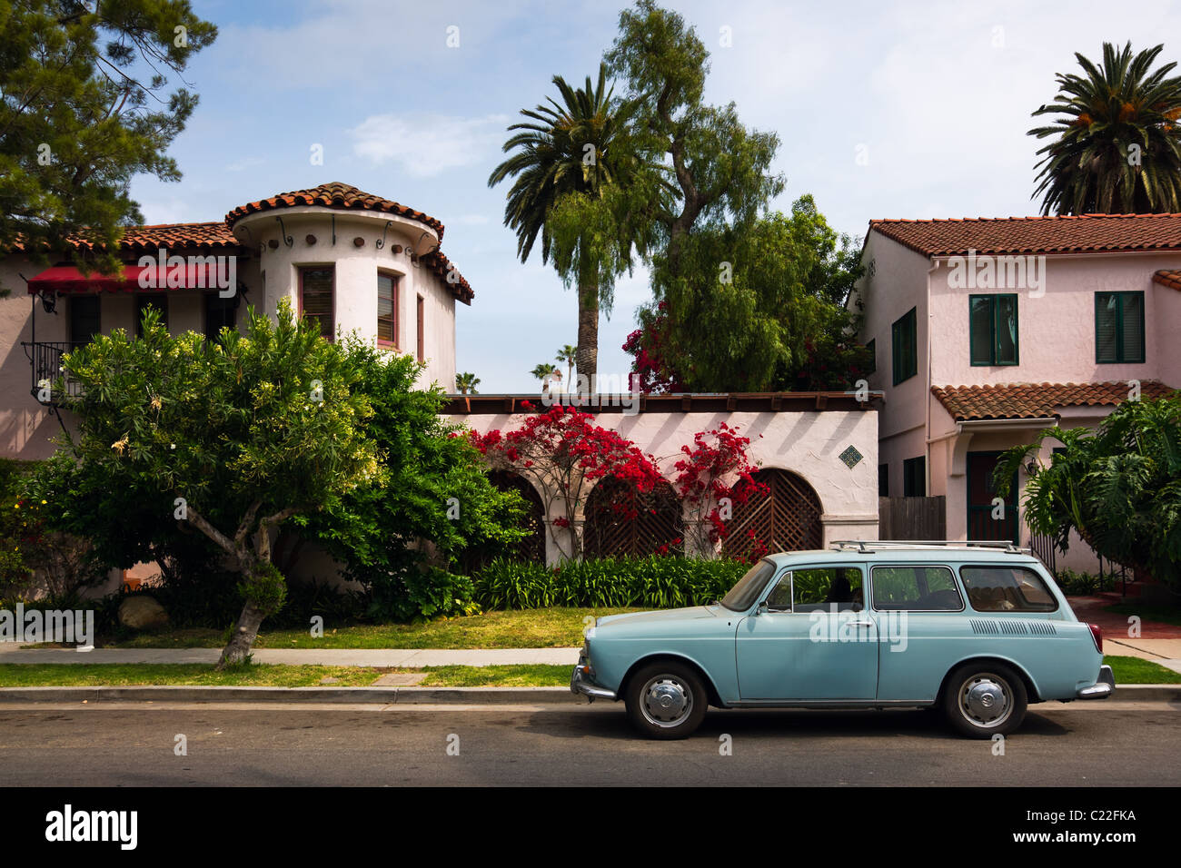 Old VW squareback wagon parked in front of a house in