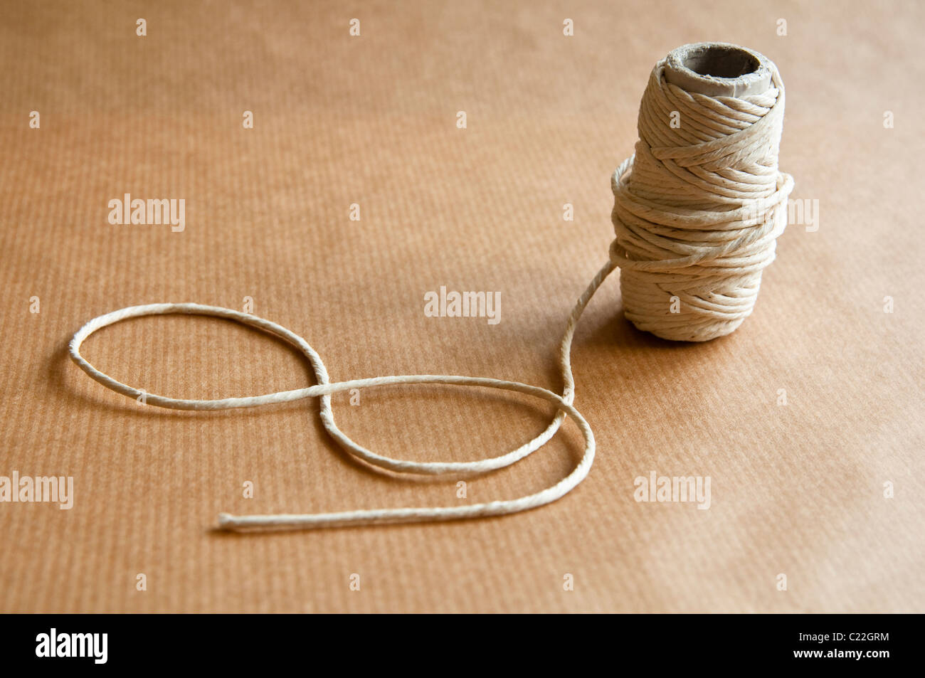 String on Brown Paper. - Stock Image