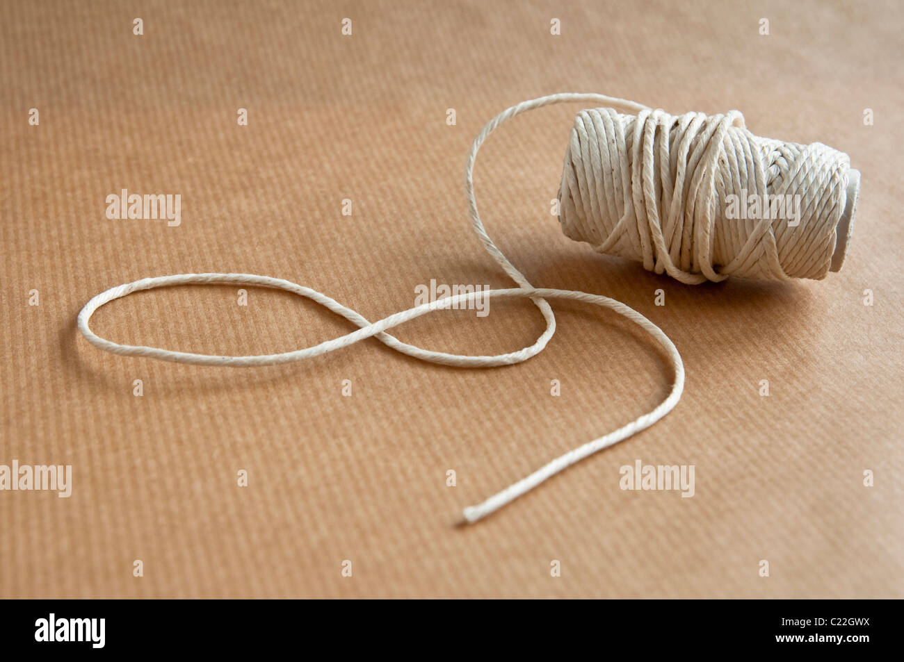 String and Brown Wrapping Paper. - Stock Image