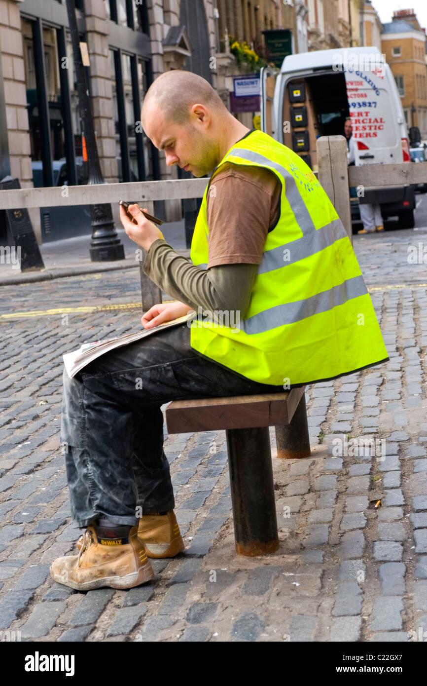 Strange Covent Gardens British Worker Sitting In Safety Jacket Inzonedesignstudio Interior Chair Design Inzonedesignstudiocom