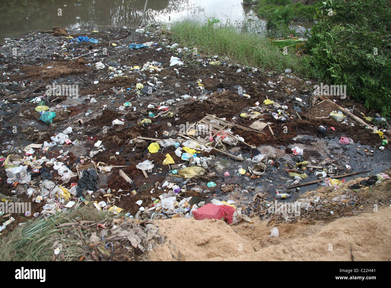 Garbage in the river - Stock Image