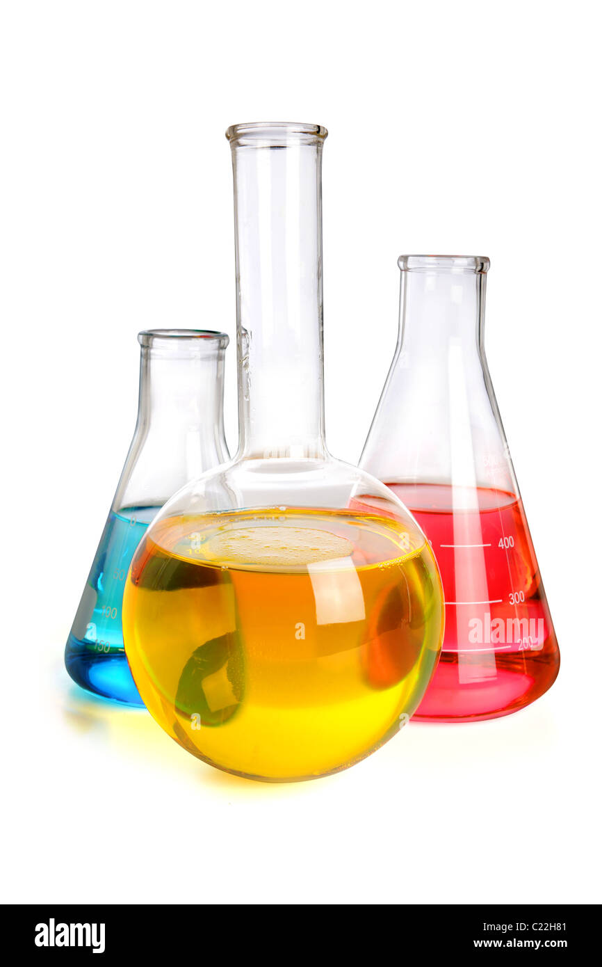 Laboratory glassware with fluids of different colors over white background - With Clipping Path - Stock Image