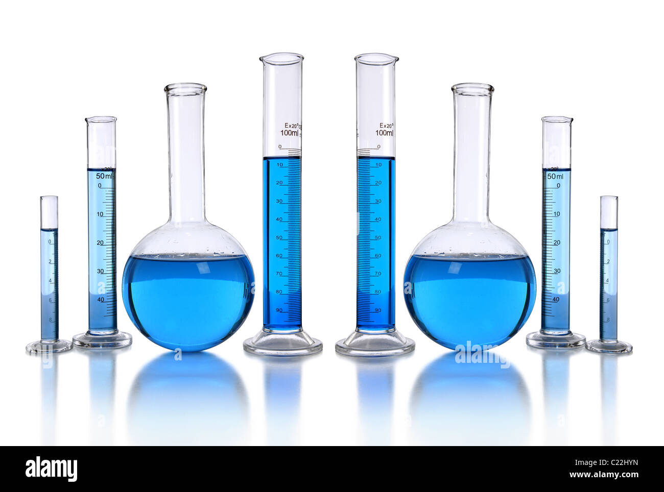 Laboratory glassware with blue liquid isolated over white background - Stock Image
