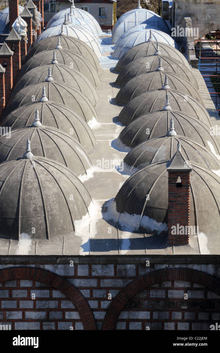 symmetrical, pointed, cupolas of a mosque roof in Istanbul, Turkey - Stock Image