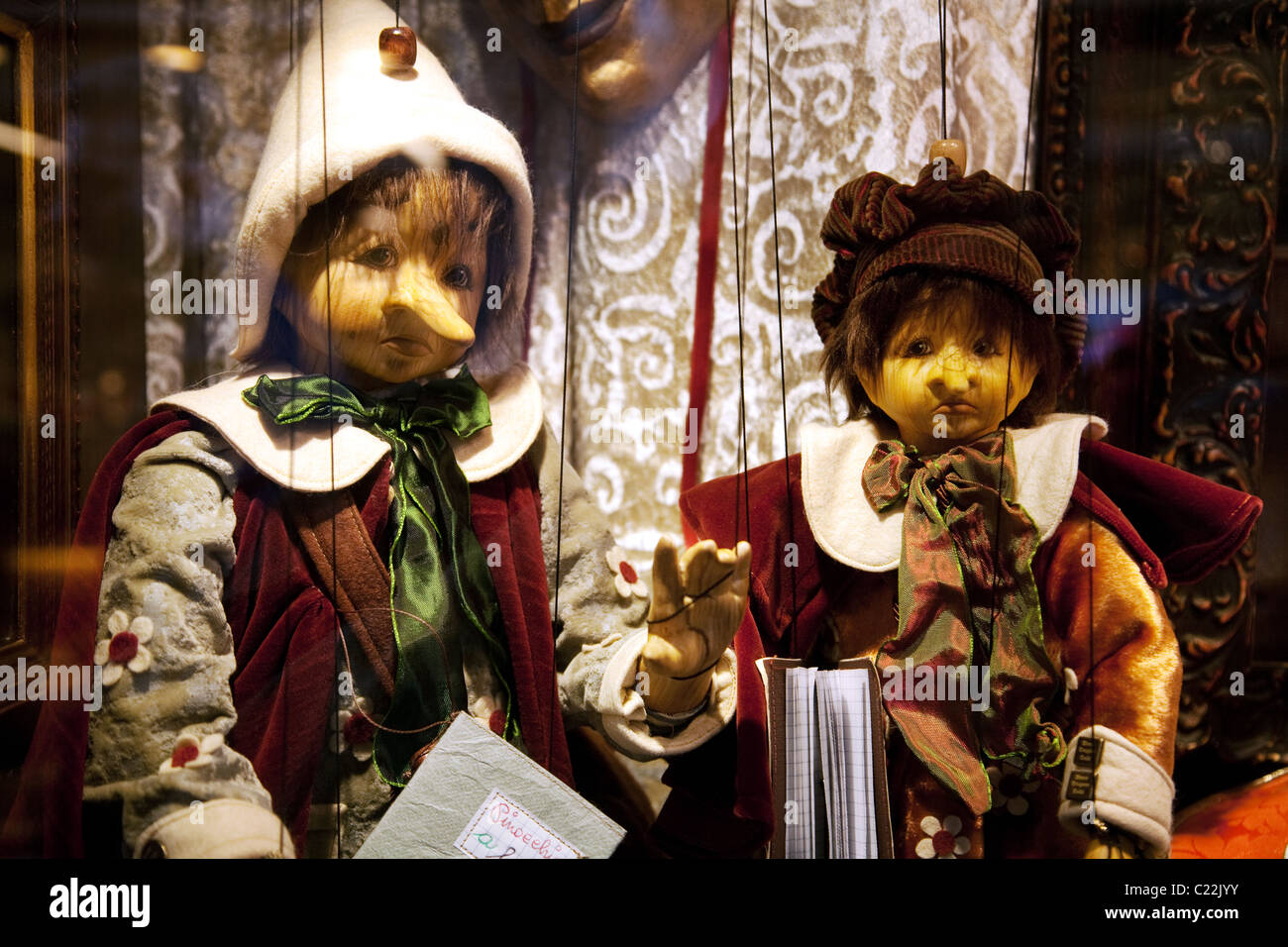 Wooden Pinocchio puppets for sale in a shop window, Venice Italy - Stock Image