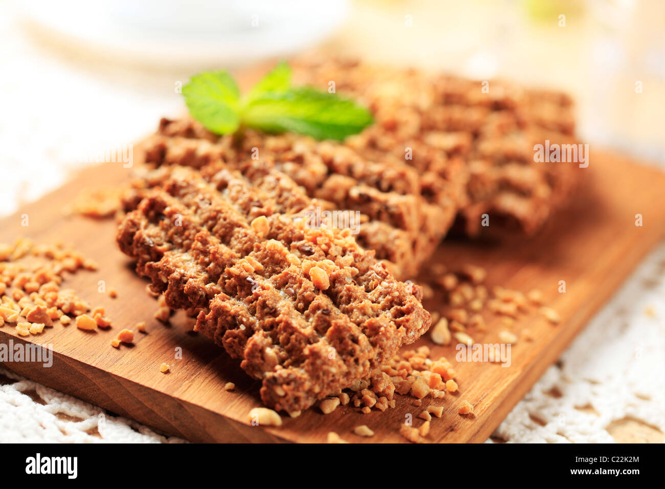 Wholegrain nutty cookies on a cutting board - Stock Image
