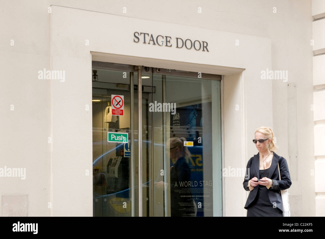 Covent Garden , Royal Opera House Stage Door With Pretty Young Blond Lady  Or Girl Or Woman In Sunglasses Waiting Outside