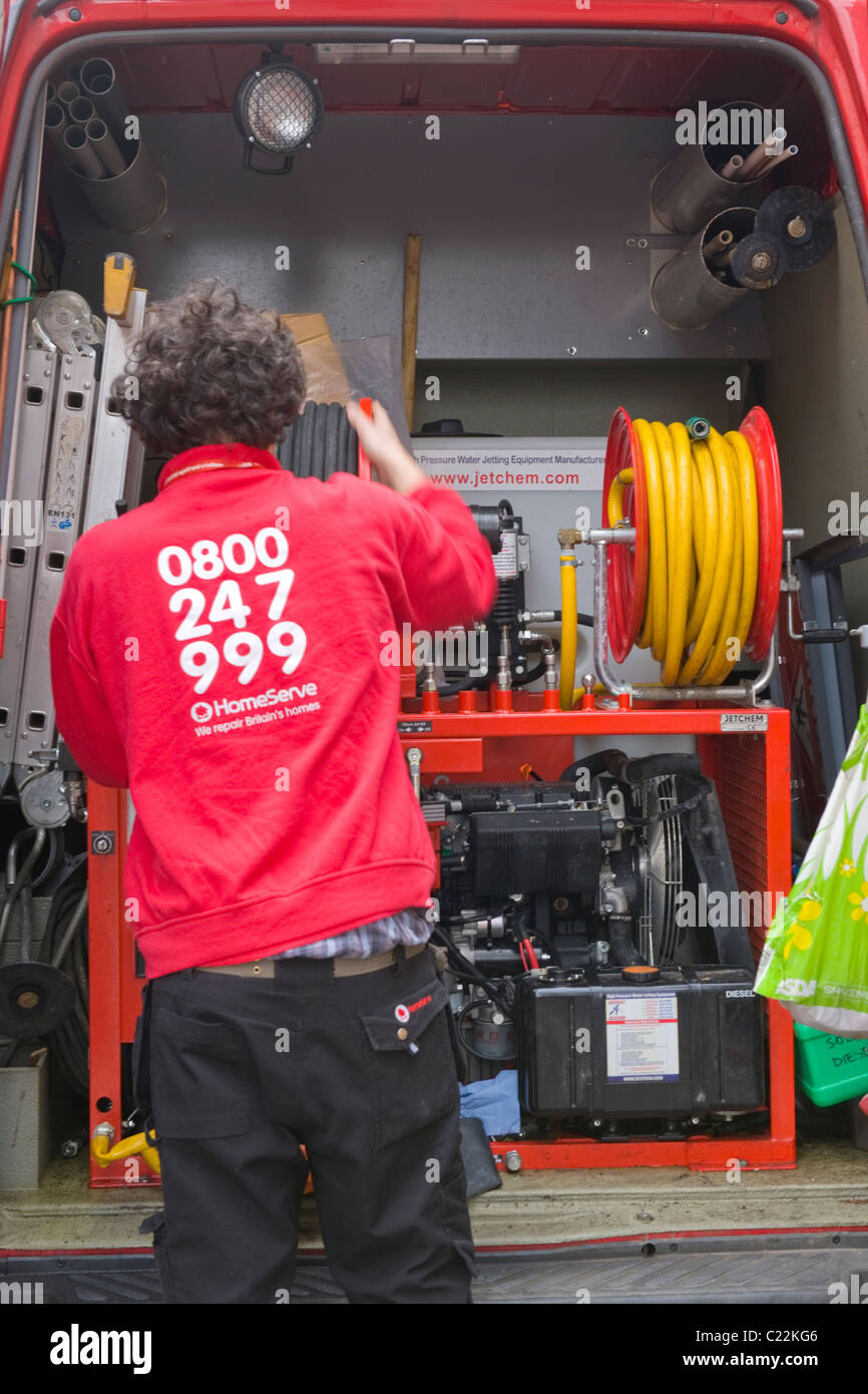 Covent Garden British Workmen Homeserve repair man or engineer loading equipment in van - Stock Image