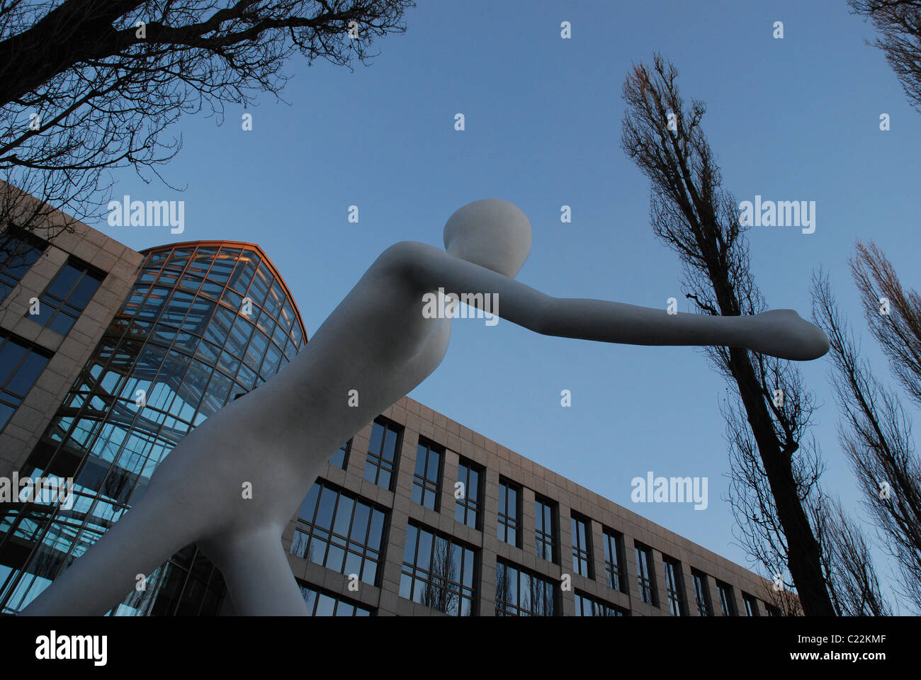 man walking in front of the Munich Reinsurance - Stock Image