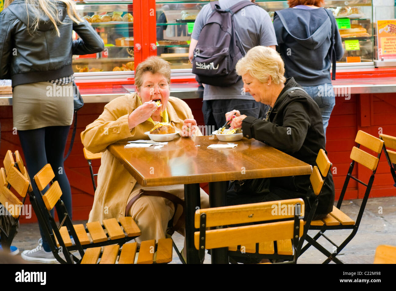 Covent Garden Two Elderly Or Old Ladies Enjoy Eating Baked