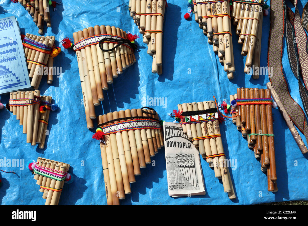 Panpipes with instruction book for learning how to play them for sale in Chinchero market , Sacred Valley , near - Stock Image