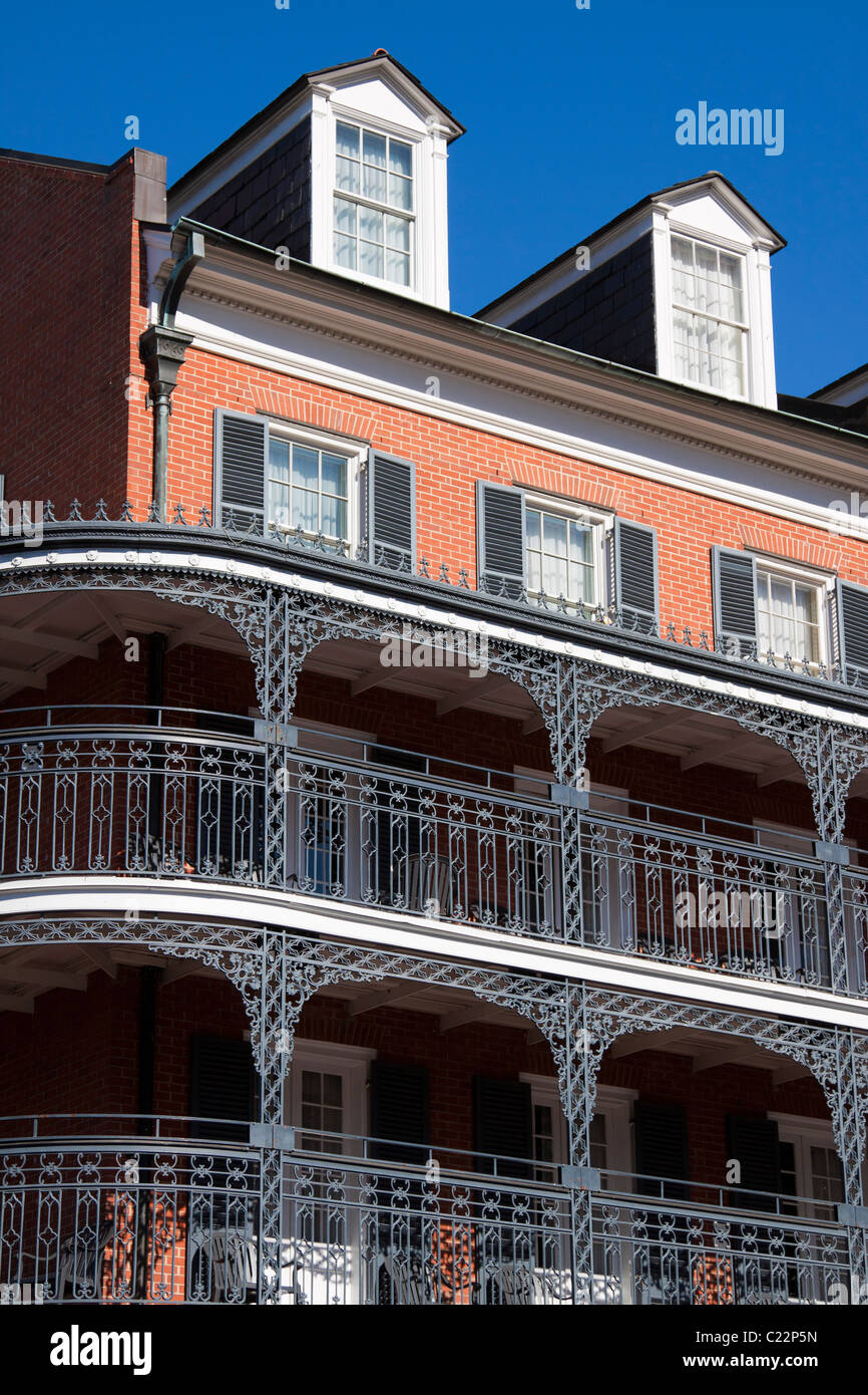 Elaborate wrought iron balcony railings of the Royal Sonesta Hotel in the French Quarter of New Orleans - Stock Image
