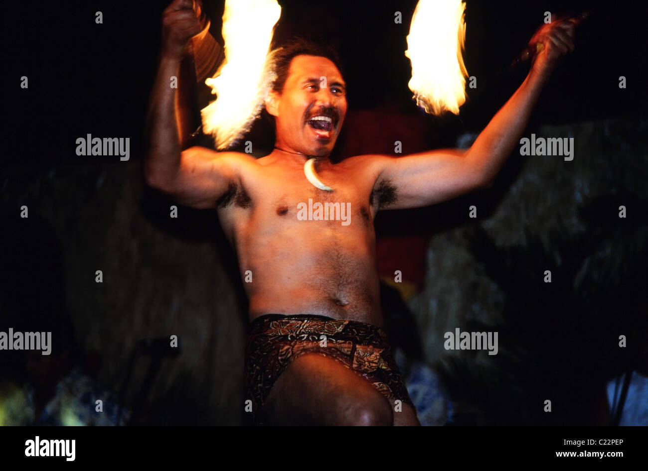 Man with flaming torches Hawaii Hula performance - Stock Image