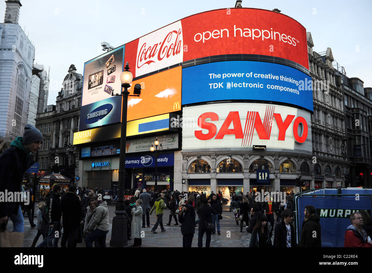 Tourists at Piccadilly Circus, London - Stock Image