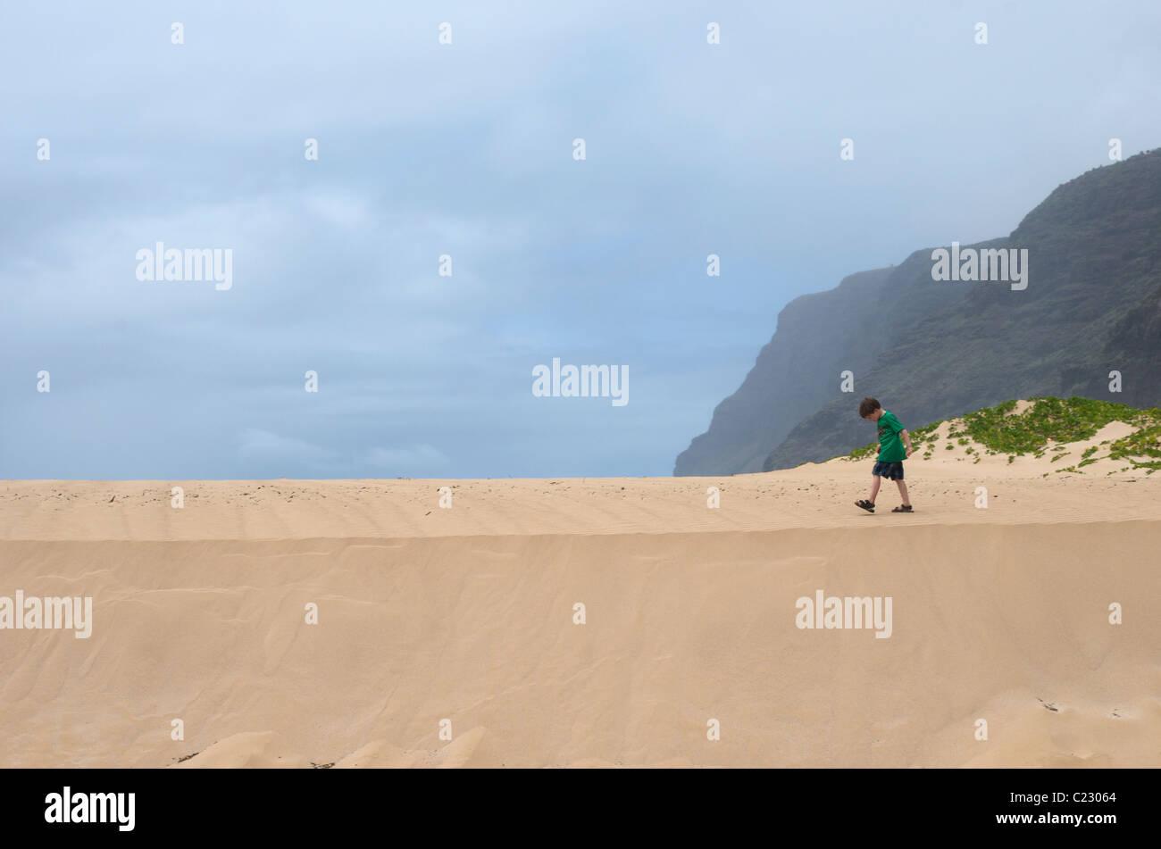 Boy walks on Sand Dune Stock Photo