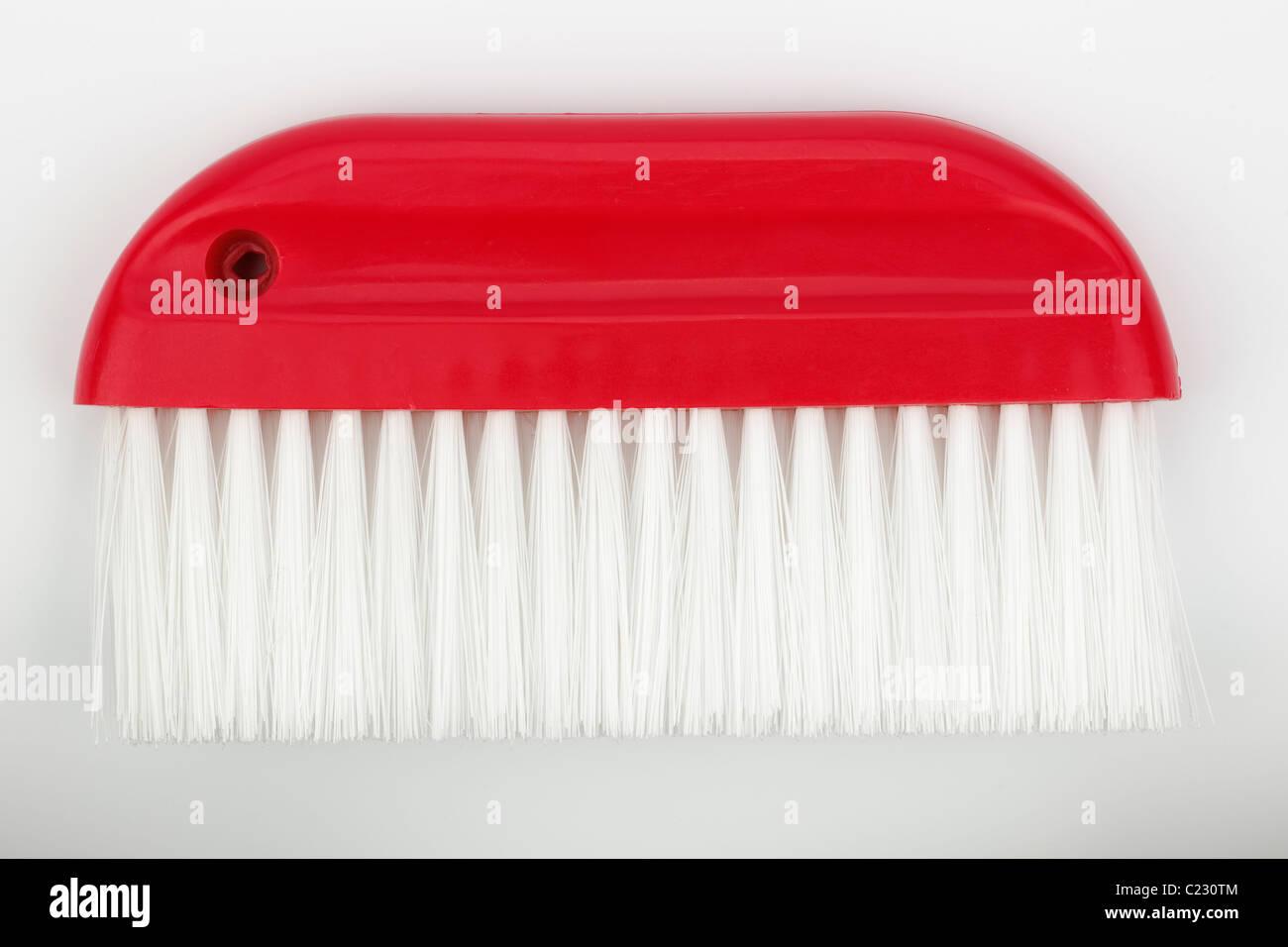 Red wallpaper smoothing brush Stock Photo