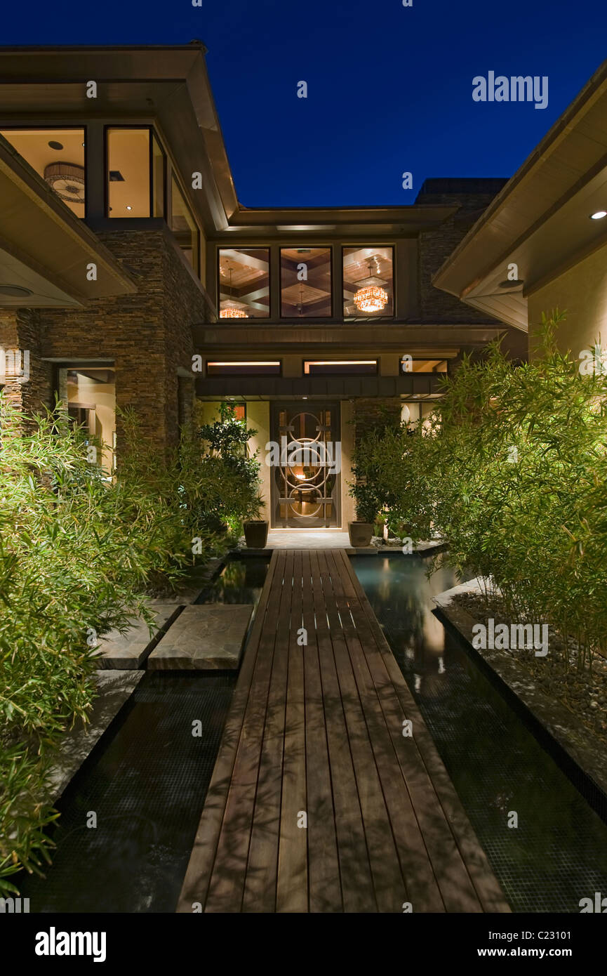 High Quality House Exterior At Night With Wooden Walkway Over Water