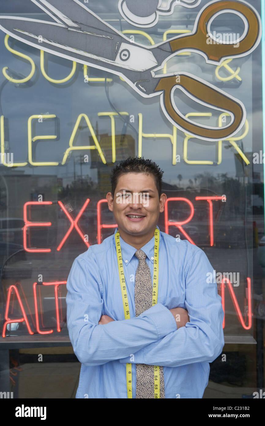 Man standing infront of laundrette shop window Stock Photo