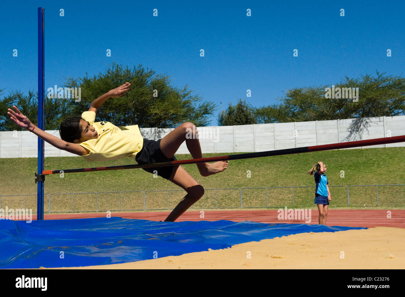 South African school girl in a high jump competition, Bellvile, Western Cape, South Africa - Stock Image