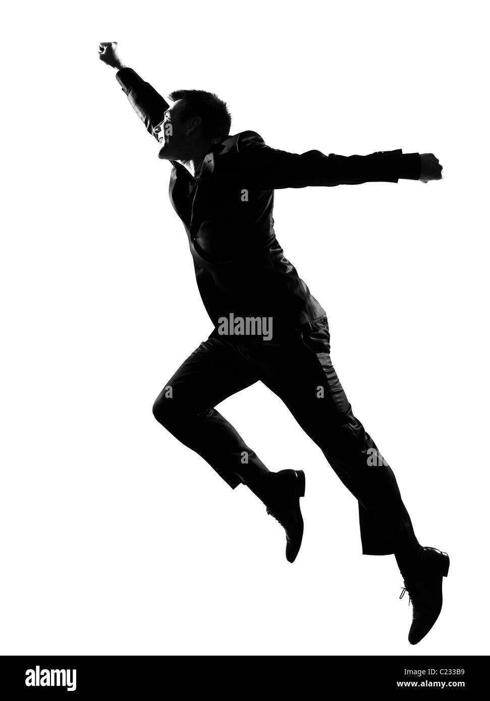 silhouette caucasian business man expressing winning behavior full length on studio isolated white background - Stock Image