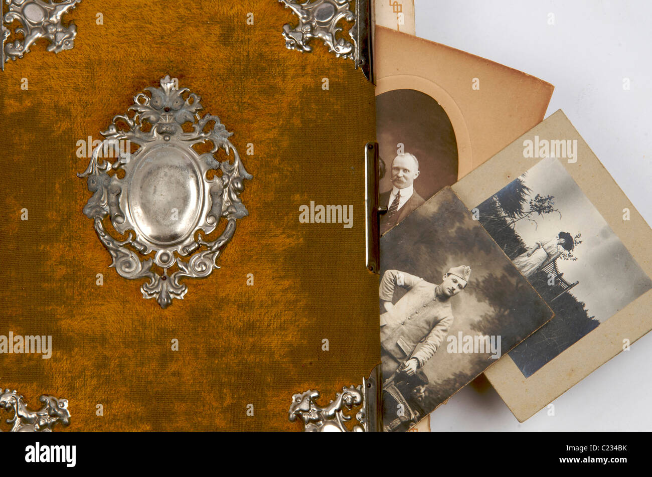 Old vintage album and photographs - Stock Image