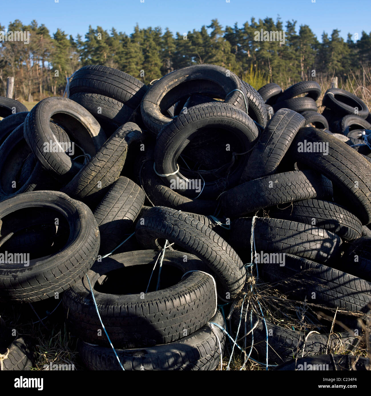 Old rubber tyres in the countryside. - Stock Image