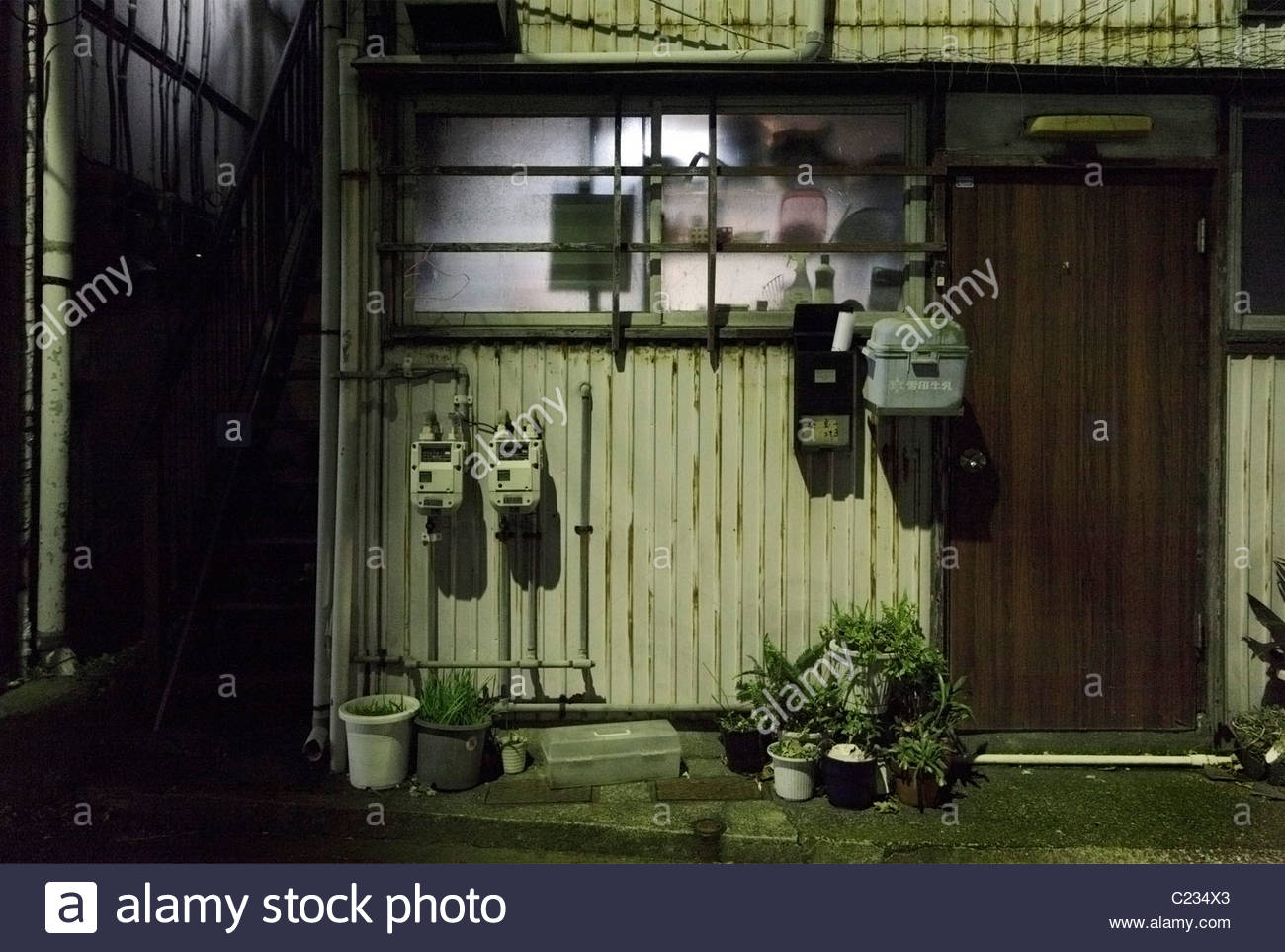 from inside lighted up kitchen window of a residential house Japan - Stock Image