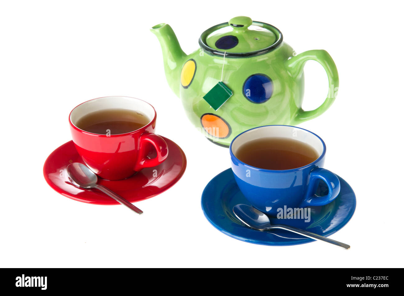 Tea pot with cups in red and blue  - Stock Image