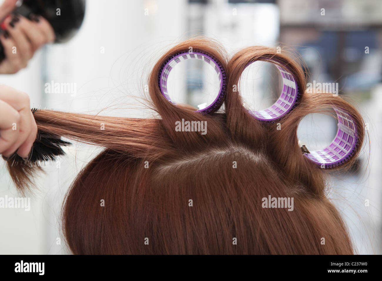 Three hairderssing rollers - Stock Image