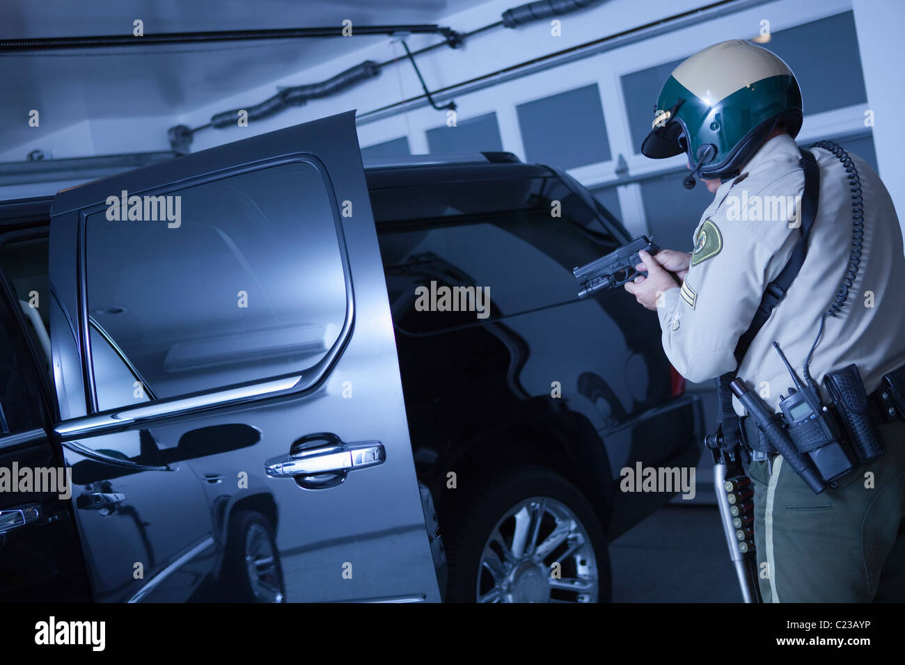 Nightwatch patrolman:stand off with luxury car in garage - Stock Image