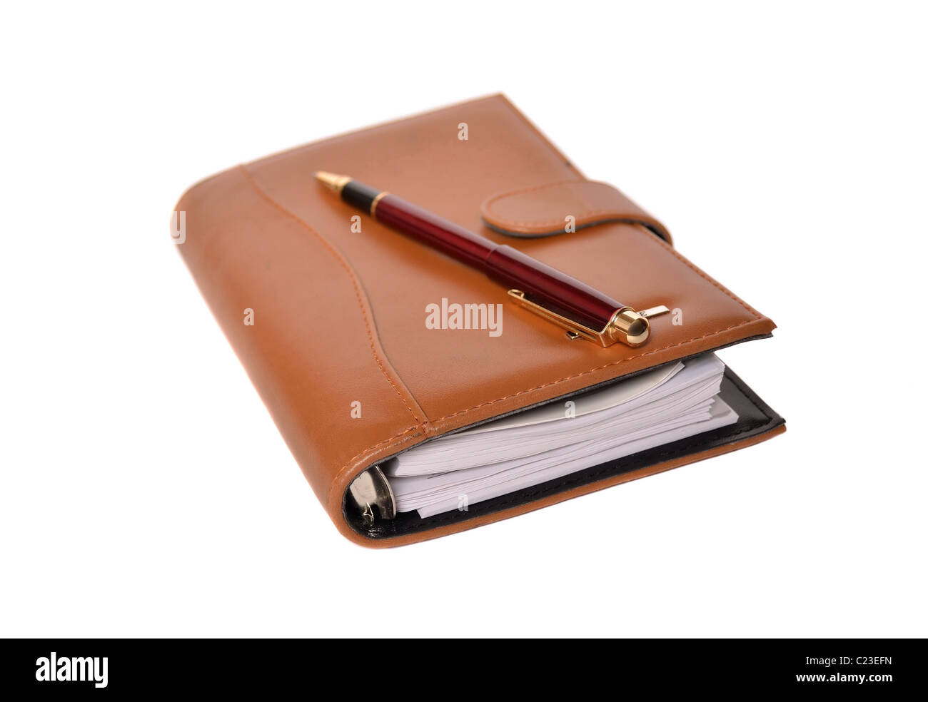 Daily planner with pen - Stock Image