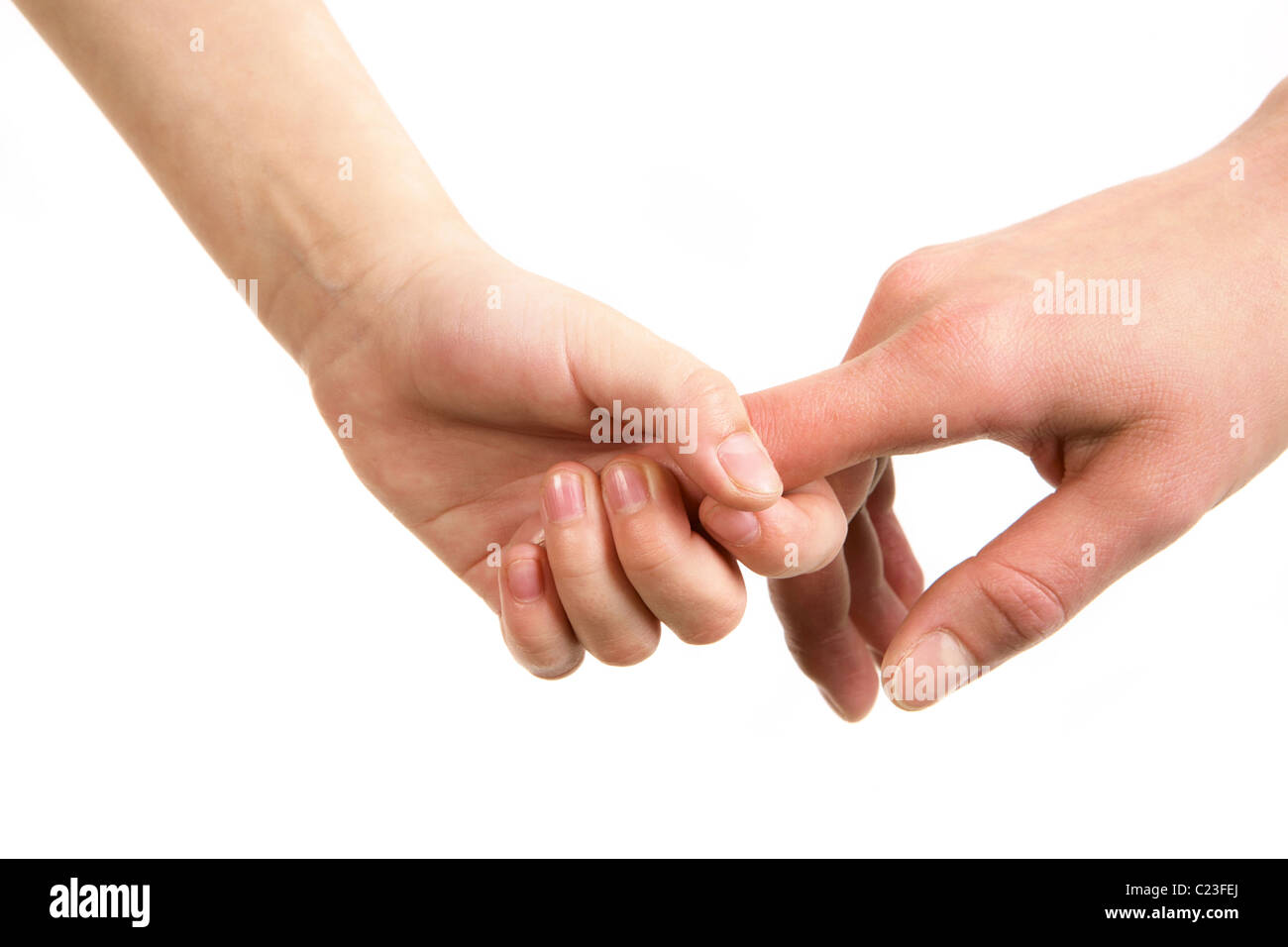 Image of parent's hand holding the one of the child - Stock Image